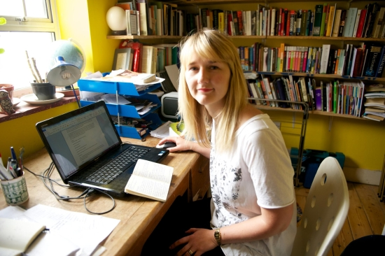 Clare Pollard at her computer